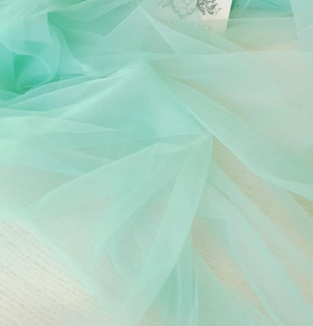 Mint green tulle fabric. Photo 2