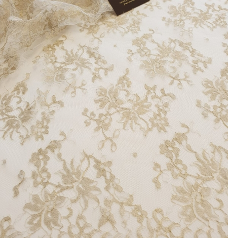 Ivory with gold thread viscose lace fabric. Photo 2