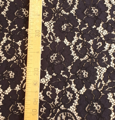 Black guipure lace fabric. Photo 7