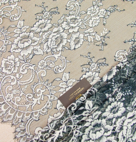Dark turquoise with white chantilly lace fabric. Photo 1