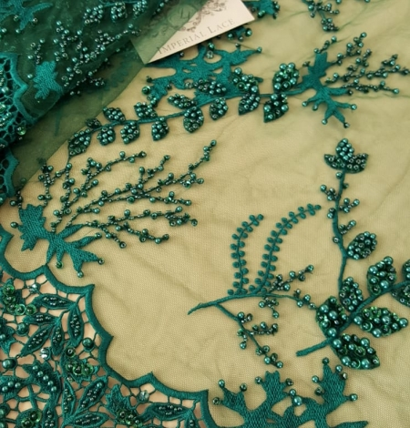 Green beaded lace fabric. Photo 6