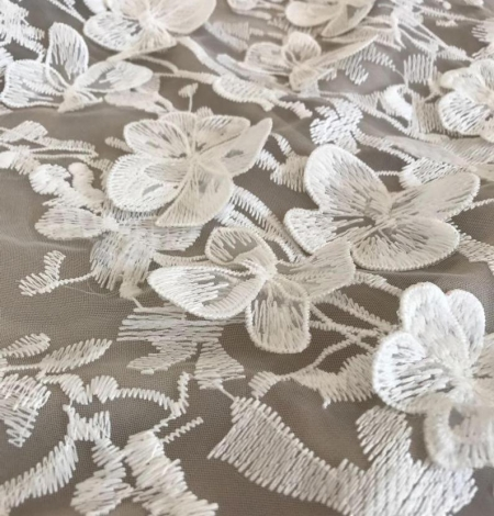 White 3D floral pattern embroidery on tulle fabric. Photo 2