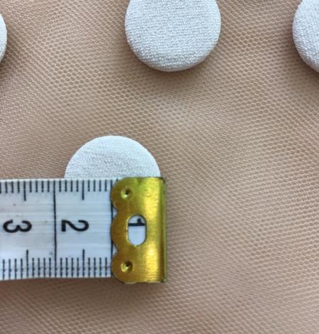 Beige button. Photo 7
