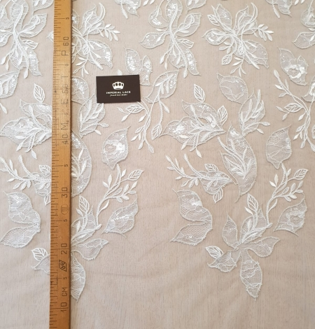 Ivory with silver thread embroidery on tulle lace fabric. Photo 7