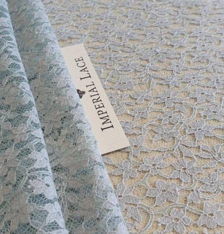 Grey with bluish green base lace fabric. Photo 2