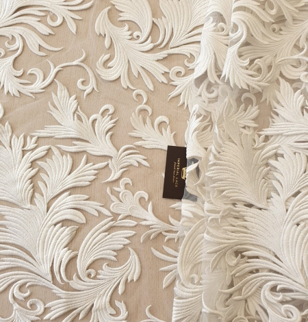 ivory thick embroidery on tulle fabric. Photo 2