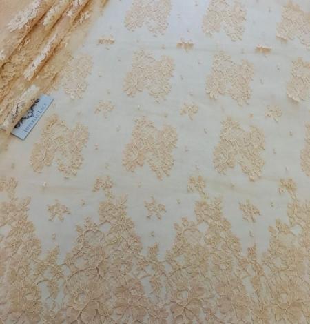 Rusty yellow lace fabric. Photo 4