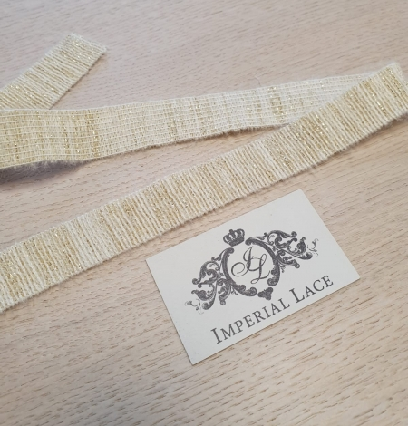 Ivory with gold thread rubber ribbon. Photo 2