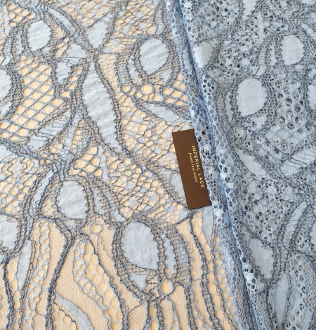 Light and dark blue chantilly lace fabric . Photo 1