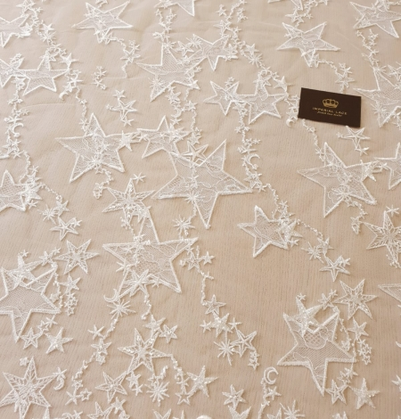 Ivory 100% polyester star pattern embroidery on tulle with beads and chantilly details lace fabric. Photo 6