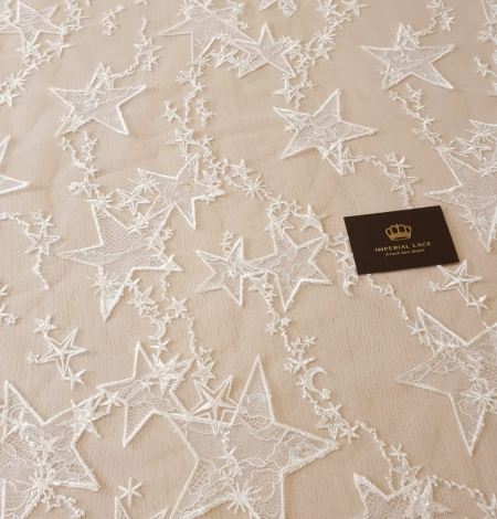 Ivory 100% polyester star pattern embroidery on tulle with beads and chantilly details lace fabric. Photo 3