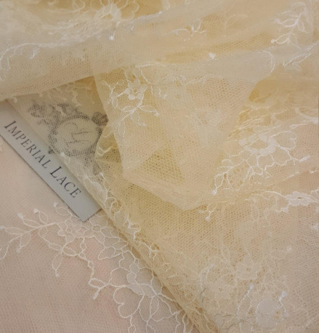 Light Yellow Lace Fabric. Photo 1
