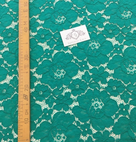 Green floral pattern guipure lace fabric. Photo 5