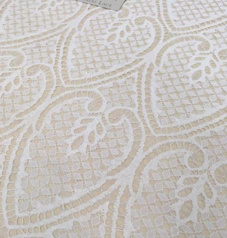 Ivory figurative lace fabric . Photo 3