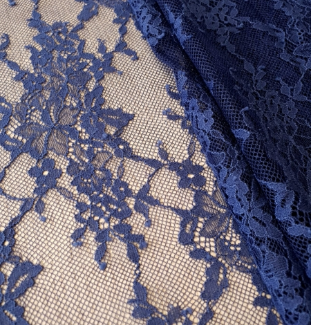 Blue 100% polyester floral chantilly lace fabric. Photo 3