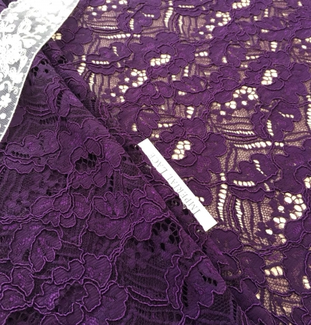 Violet guipure lace fabric. Photo 5