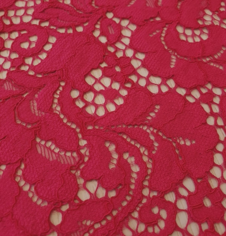 Raspberry pink 100% polyester floral pattern guipure lace fabric. Photo 3