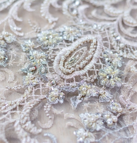 Beige embroidery on tulle fabric. Photo 4