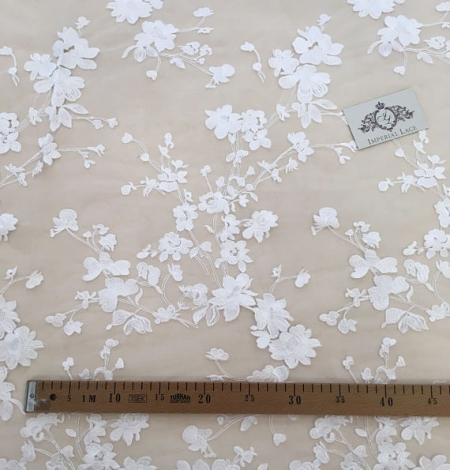 Bridal lace fabric with 3D flowers. Photo 5