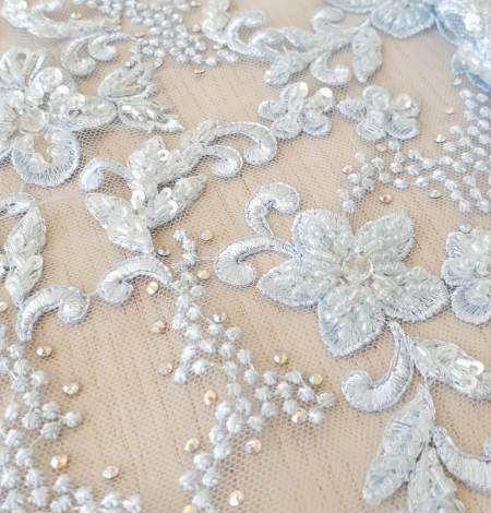 Light blue beaded embroidery on tulle fabric. Photo 3