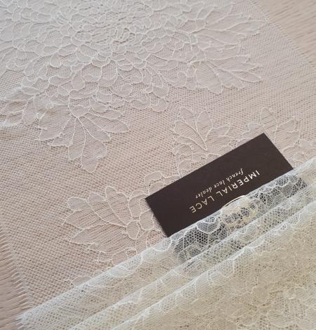 Light pistachio chantilly lace trimming . Photo 1