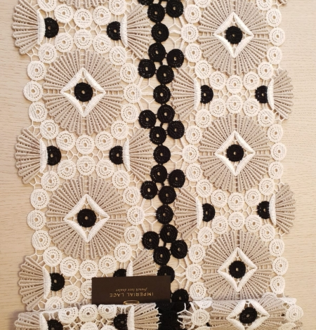 Beige with black and white macrame lace fabric. Photo 6