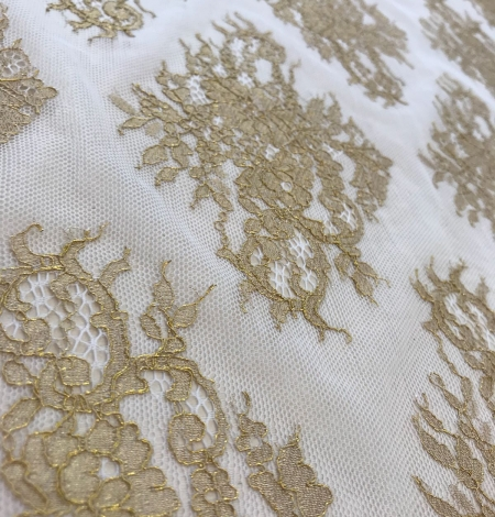 Gold lace fabric. Photo 6