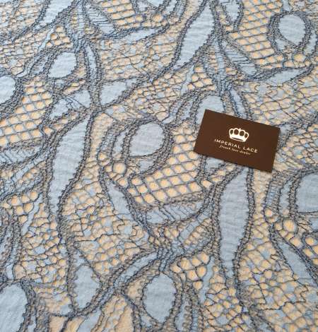 Light and dark blue chantilly lace fabric . Photo 7