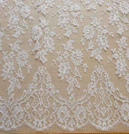White chantilly lace fabric . Photo 7