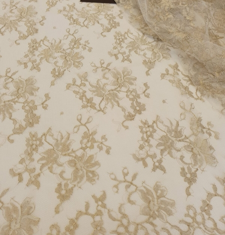 Ivory with gold thread viscose lace fabric. Photo 3