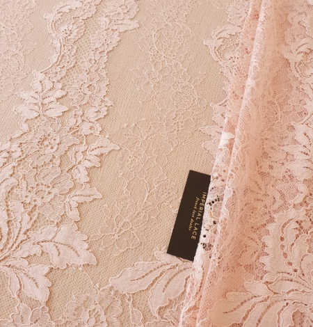 Pink guipure with chantilly lace fabric. Photo 1