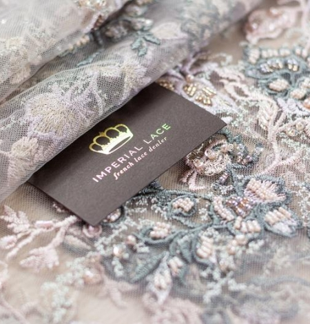 Dark greyish pink embroidery on light grey tulle fabric. Photo 2