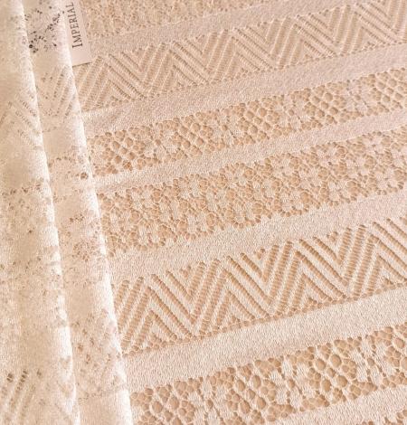 Ivory viscose chantilly lace fabric. Photo 1