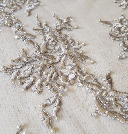 Beige embroidery on tulle fabric . Photo 4