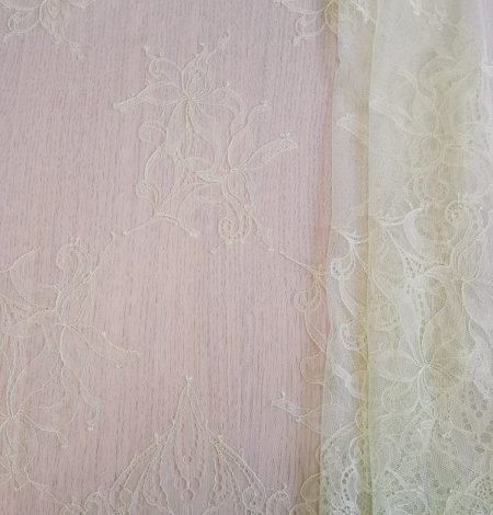 Light yellow lace fabric. Photo 6