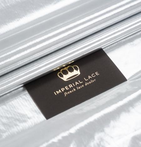 Silver color shiny rain coat fabric. Photo 1