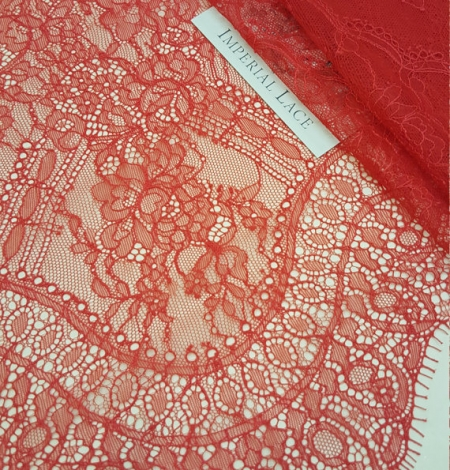 Red lace fabric. Photo 1