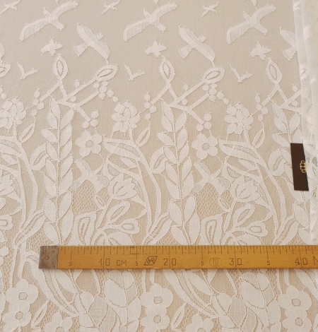 Ivory 100% polyester floral and bird pattern chantilly lace fabric. Photo 13