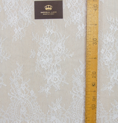 Off white floral pattern chantilly lace fabric. Photo 8