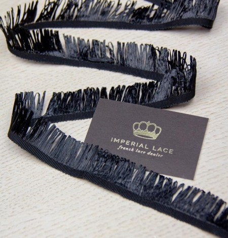 Black grosgrain ribbon with plastic fringes. Photo 4