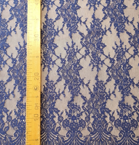 Blue 100% polyester floral chantilly lace fabric. Photo 6