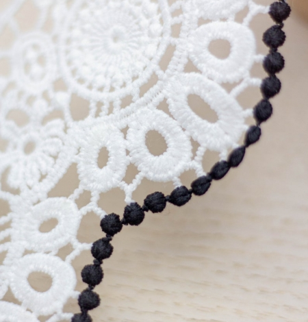 Ivory with black edge floral pattern macrame lace trim. Photo 2