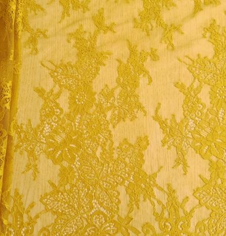 Mustard lace fabric. Photo 1