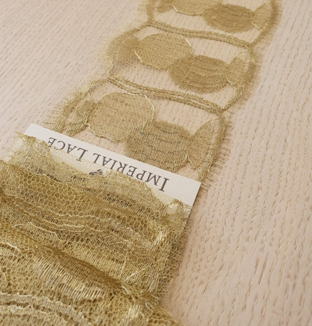 Gold chantilly lace fabric. Photo 4
