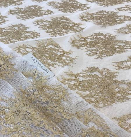 Gold lace fabric. Photo 2