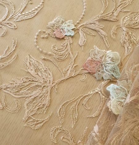 Multicolor floral 3D embroidery on beige tulle fabric. Photo 2
