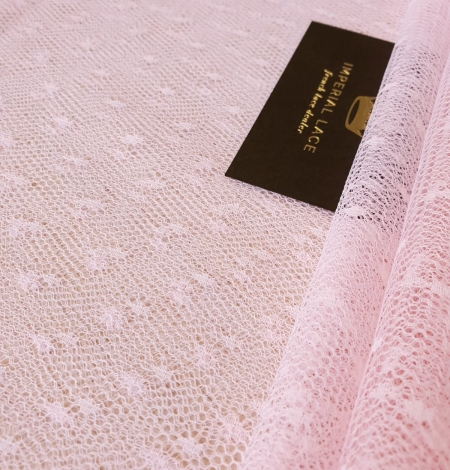 Light pink dotted tulle fabric. Photo 1