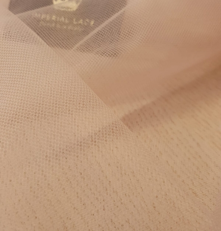 Nude 100% polyamide clear invisible tulle fabric. Photo 10