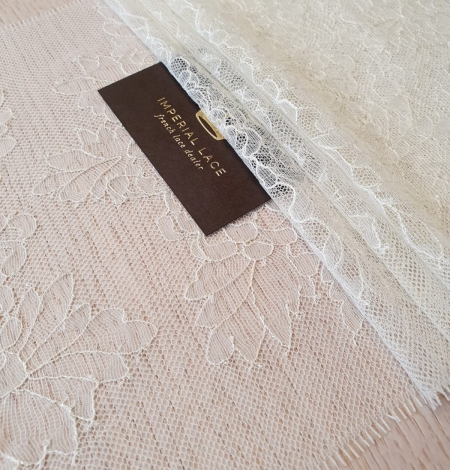 Light pistachio chantilly lace trimming . Photo 3