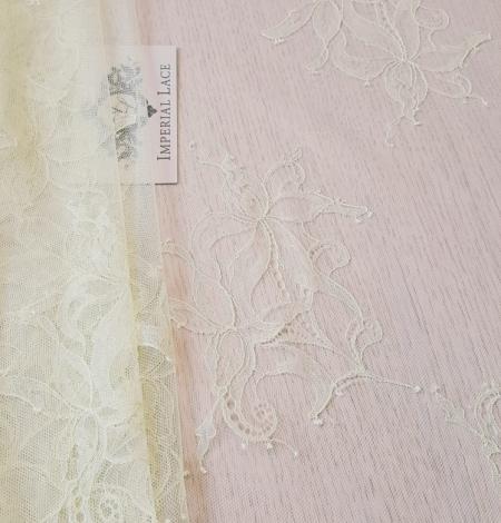 Light yellow lace fabric. Photo 3